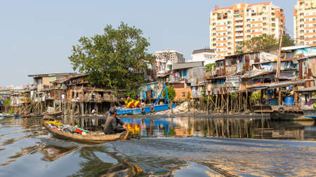 slums: HO CHI MINH, VIETNAM - JAN 10, 2015: Views of the citys Slums from Boat. Is located in the South of Vietnam, is the countrys largest city, population 8 million.