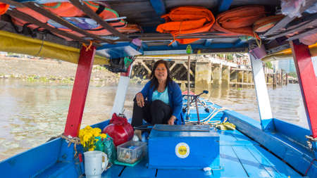 steadily: HO CHI MINH, VIETNAM - JAN 11, 2015: Local woman driver a boat. Traffic between Ho Chi Minh and southern provinces has steadily increased over years, receive 100,000 waterway vehicles every year.