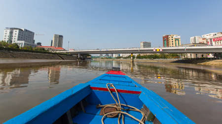 steadily: HO CHI MINH, VIETNAM - JAN 11, 2015: Views of the city from Boat. Traffic between Ho Chi Minh and southern provinces has steadily increased over years, receive 100,000 waterway vehicles every year.