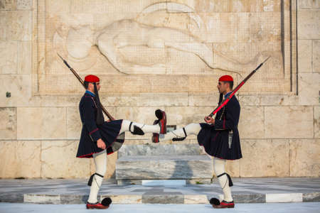 refers: ATHENS, GREECE - CIRCA APR, 2015: Evzone guarding the Tomb of Unknown Soldier in Athens dressed in service uniform, refers to the members of the Presidential Guard, an elite ceremonial unit.