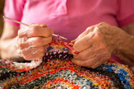 astringent: Close-up hands astringent crochet of an elderly woman.
