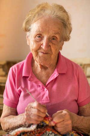 astringent: Portrait of an elderly woman to astringent crochet.