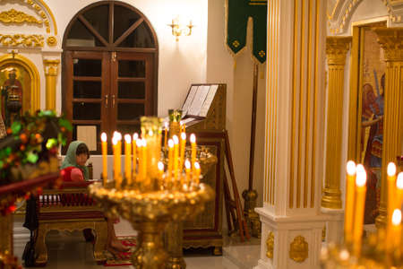 vigil: KOH CHANG - THAILAND - JAN 7, 2016: Christmas service and the vigil on Feast of the Nativity of Christ (Russian Orthodox Church) in the temple of St. Sergius of Radonezh, built on island in Jan 2015.