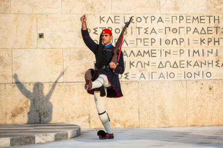 ceremonial: ATHENS, GREECE - CIRCA APR, 2015: Evzone guarding the Tomb of Unknown Soldier in Athens dressed in service uniform, refers to the members of the Presidential Guard, an elite ceremonial unit.