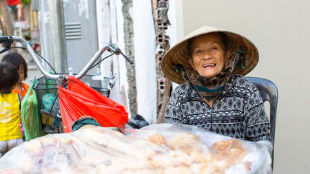 capita: HO CHI MINH CITY, VIETNAM - JAN 10, 2016: Unidentified local woman street vendor. By the end of 2014, the citys GDP grew 9.5%, with GDP per capita reaching $5100. Editorial