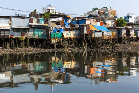 Views of the city's Slums from the river. Ho Chi Minh City, Vietnam.