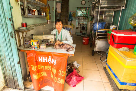 8   12: HO CHI MINH CITY, VIETNAM - JAN 12, 2016: Unidentified local woman seamstress worker. Located in the South of Vietnam, is the countrys largest city, population 8 million. Editorial
