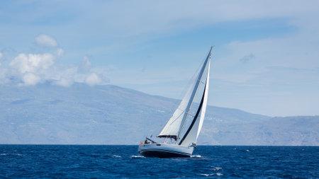 ellada: ANDROS - SYROS, GREECE - CIRCA APR, 2014: sailboats participate in sailing regatta 11th Ellada 2014 among Greek island group in the Aegean Sea, in Cyclades and Argo-Saronic Gulf.
