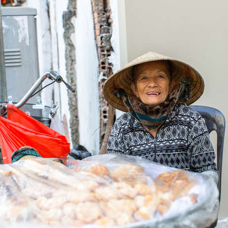 capita: HO CHI MINH CITY, VIETNAM - JAN 11, 2016: Unidentified local woman street vendor. By the end of 2014, the citys GDP grew 9.5%, with GDP per capita reaching $5100. Editorial