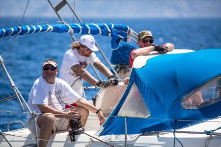 ellada: METHANA - POROS - ERMIONI, GREECE - CIRCA MAY, 2014: Sailors participate in sailing regatta 11th Ellada 2014 among Greek island group in the Aegean Sea, in Cyclades and Argo-Saronic Gulf.