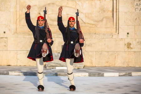 tomb of the unknown soldier: ATHENS, GREECE - CIRCA APR, 2015: Evzone guarding the Tomb of Unknown Soldier in Athens dressed in service uniform, refers to the members of the Presidential Guard, an elite ceremonial unit.