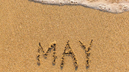 months of the year: Inscription MAY on a gentle beach sand with the soft wave (months of the year series) Stock Photo