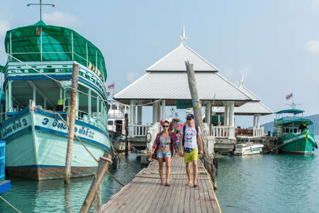 excursions: KOH CHANG, THAILAND - JAN 30, 2016: Tourist boat at the pier in Bang Bao fishing village (most touristic on the Island) From the pier of Bang Bao daily boats for excursions (500-1000 baht per person).