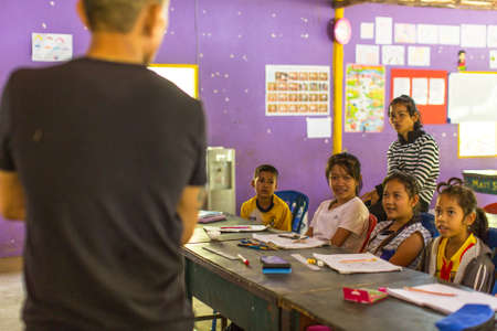 schoolroom: KOH CHANG, THAILAND - FEB 8, 2016: Unidentified children in lesson at school by project Cambodian Kids Care to help deprived children in deprived areas with education on Koh Chang island.