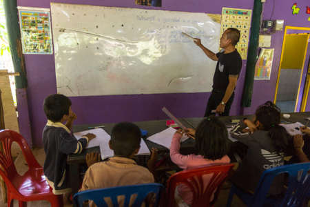 deprived: KOH CHANG, THAILAND - FEB 8, 2016: Unidentified children in lesson at school by project Cambodian Kids Care to help deprived children in deprived areas with education on Koh Chang island.