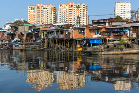 The landscape of Saigon: Views of the citys Slums from the river. Ho Chi Minh City, Vietnam.