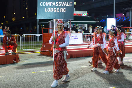 15 18: SINGAPORE - JAN 18, 2016: Unidentified participants in the celebration of Chinese Lunar New Year. Chinese New Year popularly recognised as the Spring Festival and celebrations last 15 days.