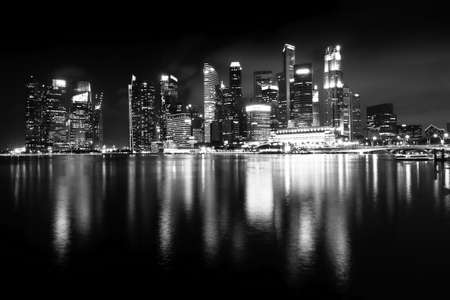 city landscape: Night views of Singapore, Marina Bay panorama, black and white photo.