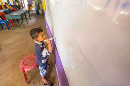 deprived: KOH CHANG, THAILAND - FEB 8, 2016: Unidentified child in lesson at school by project Cambodian Kids Care to help deprived children in deprived areas with education on Koh Chang island. Editorial