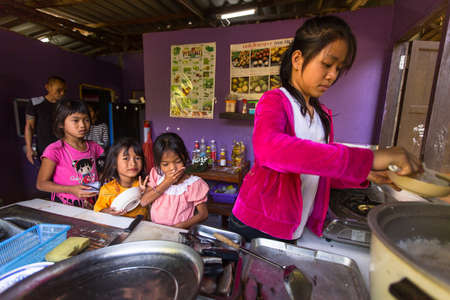deprived: KOH CHANG, THAILAND - FEB 8, 2016: Unidentified children get food at lunch time at school by project Cambodian Kids Care to help deprived children in deprived areas on Koh Chang island.