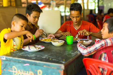 deprived: KOH CHANG, THAILAND - FEB 8, 2016: Unidentified children in the classroom at lunch time at school by project Cambodian Kids Care to help deprived children on Koh Chang island.