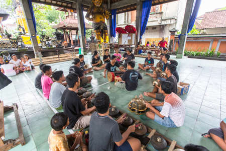 UBUD, BALI  INDONESIA - MAR 1, 2016: Unidentified teenagers at the time of preparations for Ngrupuk parade, which takes place on the eve of Nyepi day in Bali. Nyepi is a public holiday in Indonesia.