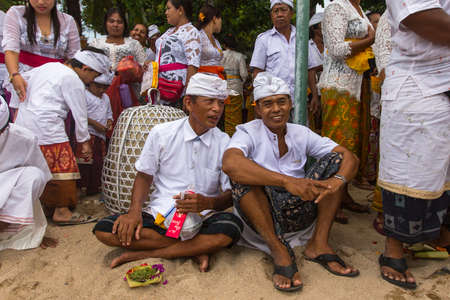 purify: SANUR, BALI - MAR 18, 2016: Unidentified people during Melasti Ritual. Ceremony is held on the edge of the beach with the aim to purify oneself of all the bad things in the past and throw it to ocean. Editorial