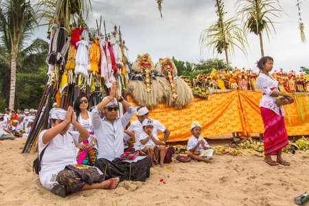 performed: SANUR, BALI - MAR 18, 2016: Unidentified local people during performed Melasti Ritual. Melasti is a Hindu Balinese purification ceremony and ritual is held several days prior to the Nyepi holy day. Editorial