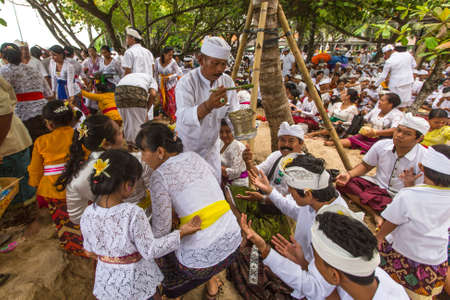 filth: SANUR, BALI - MAR 18, 2016: Unidentified people during Melasti Ritual - one of the most important rituals of Bali was meant as the ritual to cleanse the world from all the filth of sin and bad karma.