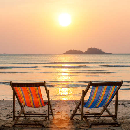 loungers: Couple of loungers on sea beach. Stock Photo
