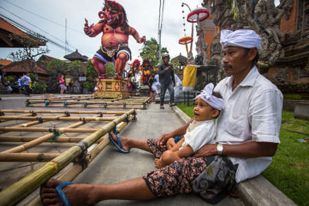 public holiday: UBUD, BALI - MAR 8, 2016: Unidentified people during the celebration of Nyepi - day of silence, fasting and meditation for the Balinese, also celebrated as New Year, is a public holiday in Indonesia. Editorial