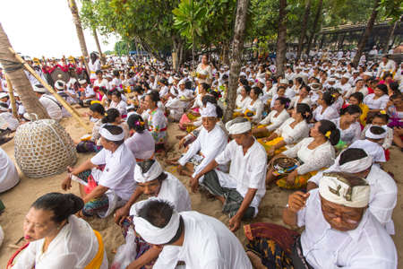 cleanse: SANUR, BALI - MAR 18, 2016: Unidentified people during Melasti Ritual - one of the most important rituals of Bali was meant as the ritual to cleanse the world from all the filth of sin and bad karma.