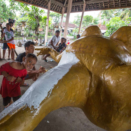 UBUD, INDONESIA - MAR 1, 2016: Unidentified local people during built Ogoh-ogoh are statues for the Ngrupuk parade, which takes place on the eve of Nyepi day. Nyepi is a public holiday in Indonesia.