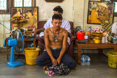 yantra: WAT BANG PHRA, THAILAND - MAR 18, 2016: Unknown monk makes traditional Yantra tattooing during Wai Kroo Master Day Ceremony in Bang Pra monastery, about 50 km west of Bangkok.