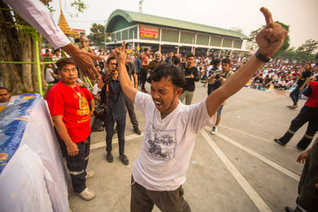 possession: WAT BANG PHRA, THAILAND - MAR 19, 2016: Unknown participants Master Day Ceremony at able Khong Khuen - spirit possession during the Wai Kroo ritual at Bang Pra monastery, about 50 km west of Bangkok.