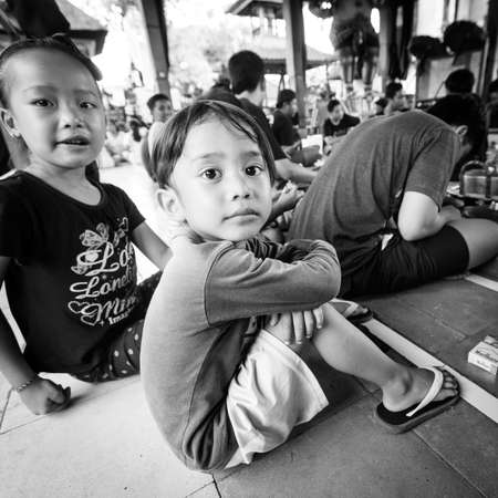 place for children: UBUD, BALI  INDONESIA - MAR 1, 2016: Unidentified children at the time of preparations for Ngrupuk parade, which takes place on the eve of Nyepi day in Bali. Nyepi is a public holiday in Indonesia. Editorial