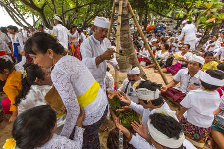 sanur: SANUR, BALI - MAR 18, 2016: Unidentified local people during performed Melasti Ritual. Melasti is a Hindu Balinese purification ceremony and ritual is held several days prior to the Nyepi holy day. Editorial