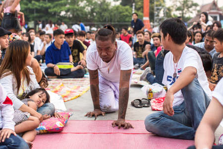 possession: WAT BANG PHRA, THAILAND - MAR 19, 2016: Unknown participants of Master Day Ceremony at able Khong Khuen - spirit possession during the Wai Kroo ritual at Bang Pra monastery, about 50 km west of Bangkok. Editorial