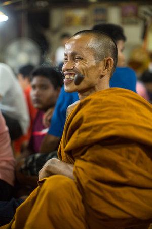 yantra: WAT BANG PHRA, THAILAND - MAR 19, 2016: Unidentified monk master Yantra Tattoos during Master Day Ceremony at Bang Phra monastery, about 50 km west of Bangkok.