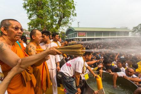 yantra: WAT BANG PHRA, THAILAND - MART 19, 2016: Blessing with Holy water of participants Wai Kroo (Luang Por Phern) Master Day Ceremony at Wat Bang Phra monastery, about 50 km of Bangkok.