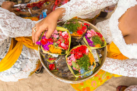 procession: SANUR, BALI - MAR 18, 2016: Unidentified people during Melasti Ritual. Ceremony is held on the edge of the beach with the aim to purify oneself of all the bad things in the past and throw it to ocean. Editorial