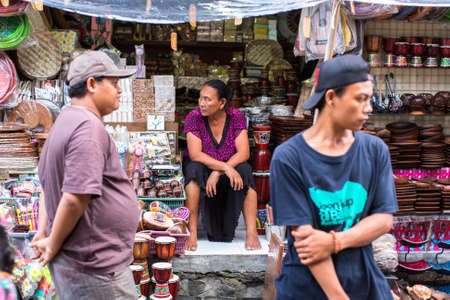BALI, INDONESIA - FEB 24, 2016: Unidentified local street vendors, souvenir. During the peak tourist season in Legian - Kuta - Seminyak, the population increased to 200 thousand people. Editorial