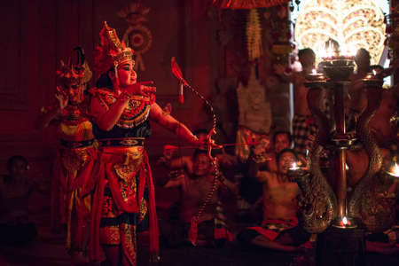chant: UBUD, BALI  INDONESIA - FEB 27, 2016: Unidentified dancers performing traditional balinese Kecak Trance Fire Dance. Kecak (also known as Ramayana Monkey Chant) is very popular cultural show on Bali. Editorial