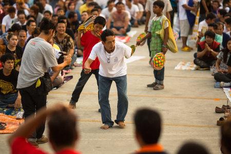 nakhon pathom: WAT BANG PHRA, THAILAND - MAR 19, 2016: Unknown participants of Master Day Ceremony at able Khong Khuen (spirit possession) during the Wai Kroo ritual at Bang Pra monastery, about 50 km of Bangkok. Editorial