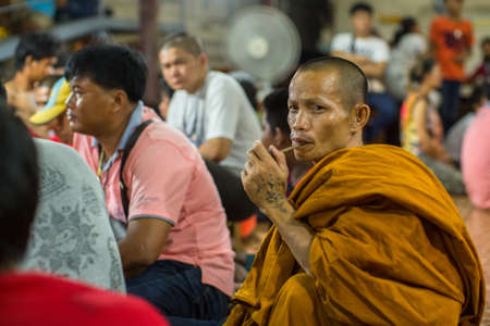 yantra: WAT BANG PHRA, THAILAND - MAR 19, 2016: Unidentified monk master Yantra Tattoos during Master Day Ceremony at Bang Phra monastery, about 50 km west of Bangkok.
