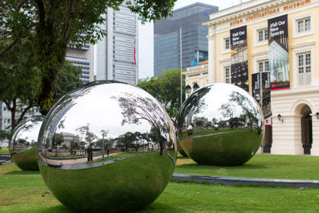 civilizations: SINGAPORE - JAN 19, 2016: Mirror Balls in Empress Place in front of Asian Civilizations Museum. On Sep 2014, the Museum was named the top museum in Singapore, ranked among Asia's top 10 museums. Editorial