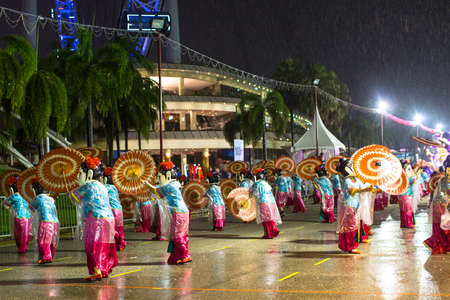 ranked: SINGAPORE - JAN 19, 2016: Unidentified participants Chingay Parade. Parade is ranked as largest street festival in Asia. This year braved the rain in the parade was attended by 8,000 participants.