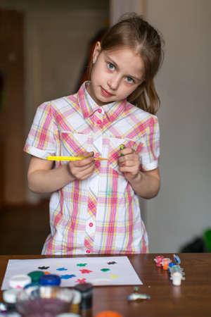 paints: Little girl draws paints. Stock Photo