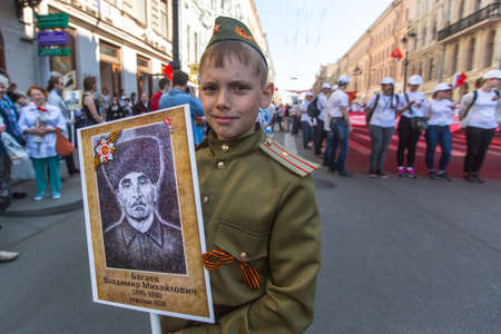 immortal: St.PETERSBURG, RUSSIA - MAY 9, 2016: Participants of Immortal Regiment - public action, during which participants carried bannersportraits of their relatives who participated in Great Patriotic War.