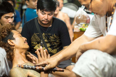 yantra: WAT BANG PHRA, THAILAND - MAR 18, 2016: Unknown participants of Master Day Ceremony at able Khong Khuen (spirit possession) during the Wai Kroo ritual at Bang Pra monastery, about 50 km of Bangkok.